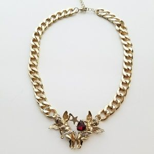Topshop Gold Cupid Necklace.